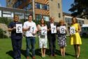 Elaine MacNicoll, Senior Marie Curie Nurse Tayside, with the Lindsay family Peter, Claire, parents Alex and Elizabeth and Marie Cure patron Petra McMillan celebrate the fundraising milestone.
