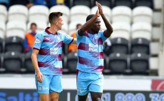 Elton Ngwatala, right, celebrates his goal.