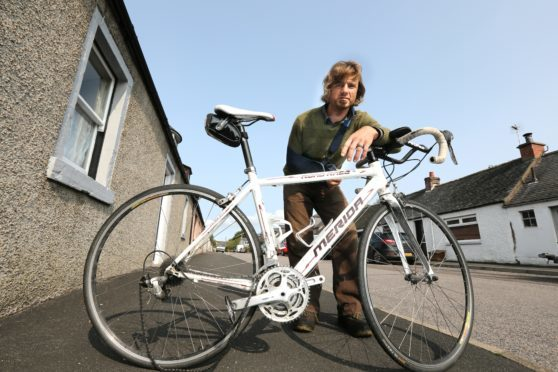 Patrick Duncan of Luthermuir with his damaged bike.
