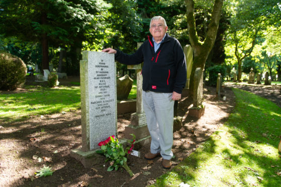 Richard Calcott showing his respect at the grave site of Sgt Alan Paterson ahead of his trip to Bleasby to attend the memorial service.
