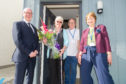 Kevin Stewart MSP with Ann and Ronnie Hogg and Abertay Housing Association chair Kath Mands at the new Forfar development.