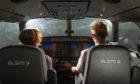 Caroline Strain and pilot Gavin Ritchie on the flight simulator.