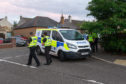The police presence at the scene of the incident, Old Halkerton Road, Forfar