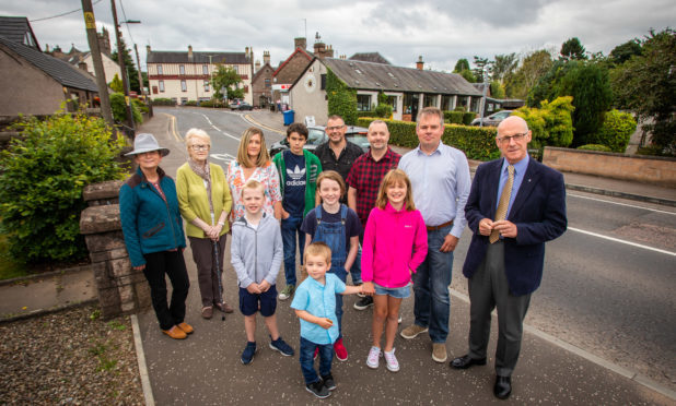 John Swinney MSP (far right) alongside Kevin Stirling (Safer Meigle Campaign Group) and local residents in the centre of Meigle. Alyth Road, Meigle A94.