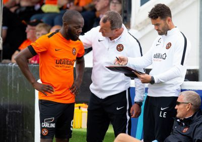 Yannick Loemba gets instructions from manager Csaba Laszlo and assistant Laurie Ellis.