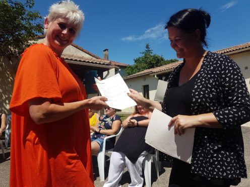 Dawn (left) receives her certificate.