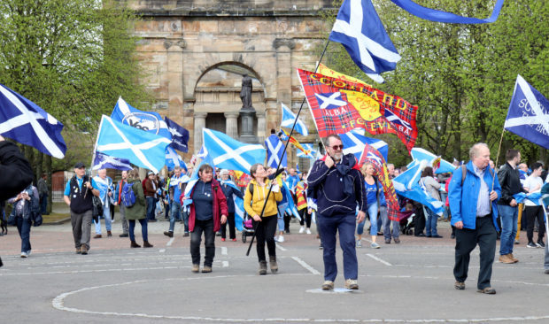 Scottish Independence supporters marching through the streets of Glasgow, as part of the All Under One Banner event on May 5 2018.