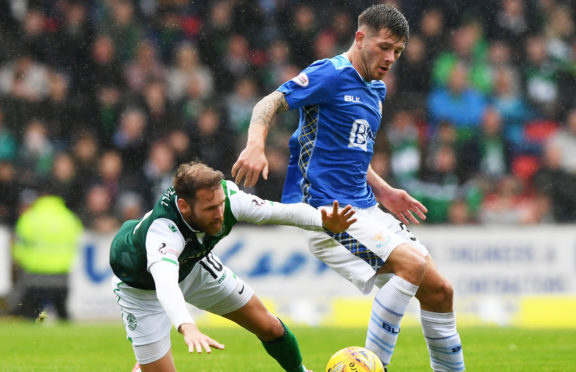 St Johnstone's Matty Kennedy challenges Martin Boyle on Sunday.