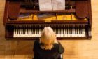 The Caird Hall piano has been put up for sale.