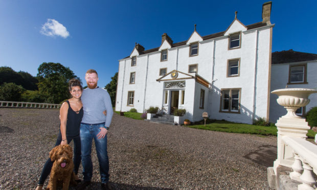 Carphin House owners Ruth and Ian Macallan with dog Hugo
