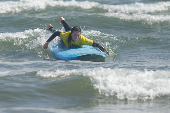 Gayle gets the hang of surfing at West Sands, St Andrews.