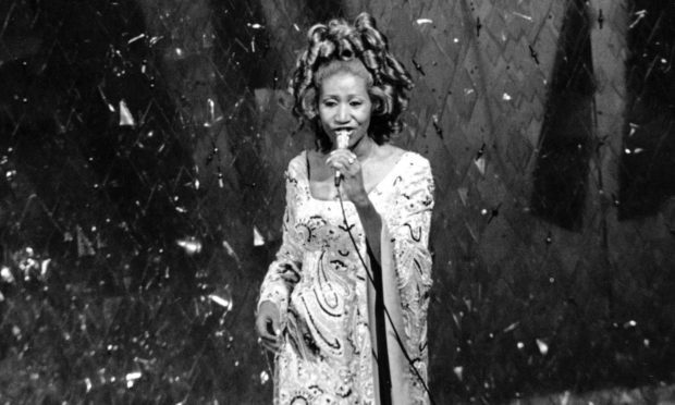 Aretha Franklin performs at the Oscars in 1975.