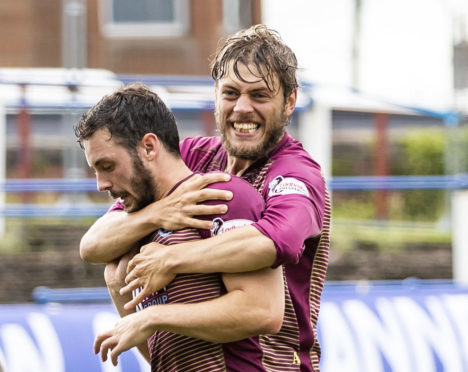 Murray Davidson celebrates with Drey Wright at Palmerston.