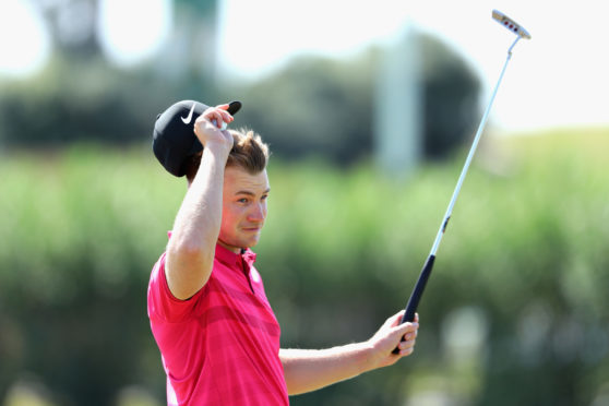 Oliver Fisher celebrates after finishing the first 59 scored on the European Tour during Day Two of the Portugal Masters at Vilamoura.