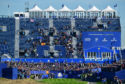 Rory McIlroy tees off in front of the massive grandstand at the first hole at Le Golf National.