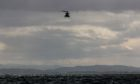 The UK Coastguard helicopter above the River Tay.