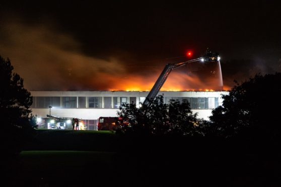 Firefighters tackle the Braeview Academy blaze.