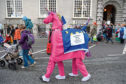 "Demonstrators dressed as the ""Brexit Unicorn"" take part in the March For The Many, calling for a people's vote on the final outcome of the government's Brexit negotiations, during the first day of the annual Labour Party conference."