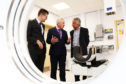 Rory McCrimmon, Dean of the School of Medicine, Chief Executive Malcolm Wright and Professor Dilip Nathwani, Co-Director of AHSP (Academic Health  and Science Partnership) with the new CT Scanner.