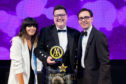 Jamie Scott of The Newport collects his award from Claudia Winkleman and Simon Numphud, managing director of AA Hotel & Hospitality Services.