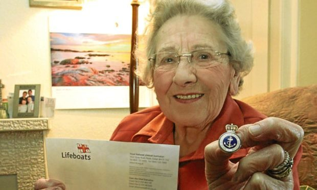 Annie Milne with one of her RNLI awards.