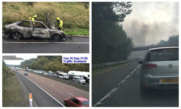 Photos showing the ruins of the car which caught fire on the M90.
