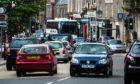 General view of traffic in Crieff High Street.