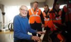 Dave Patterson with ScotRail staff on the day the new piano was installed.
