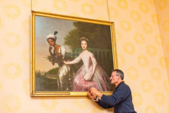 Graham McIntyre, curator at Scone Palace adds new plaque to portrait of Dido Belle and Lady Elizabeth Murray now naming Scots artist David Martin as its creator.