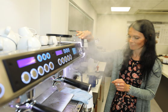 Gayle gets steaming, during barista training at the James Aimer Coffee Factory in Dundee.