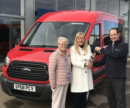 Scott Davidson of Am Phillip Trucktech hands over the keys to Rev Barbara Ann Sweetin, who is accompanied by Eleanor Stewart.