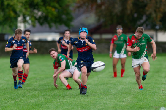 High hooker Angus Campbell chases a loose ball during the 37-19 loss to GHA.