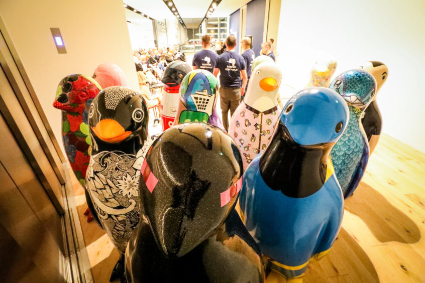 The penguins lined up for the auction.