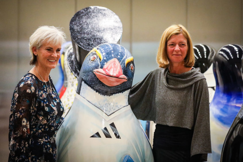 Judy Murray and Laura Lee after Judy won a bid in the auction for a penguin signed for and inspired by her son, Sir Andy Murray.