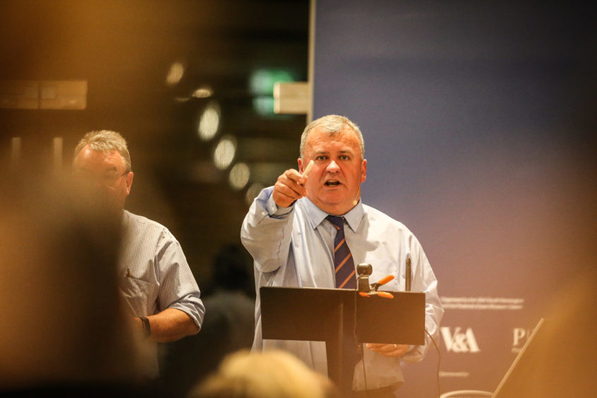 ANM Group auctioneers get the proceedings under way.