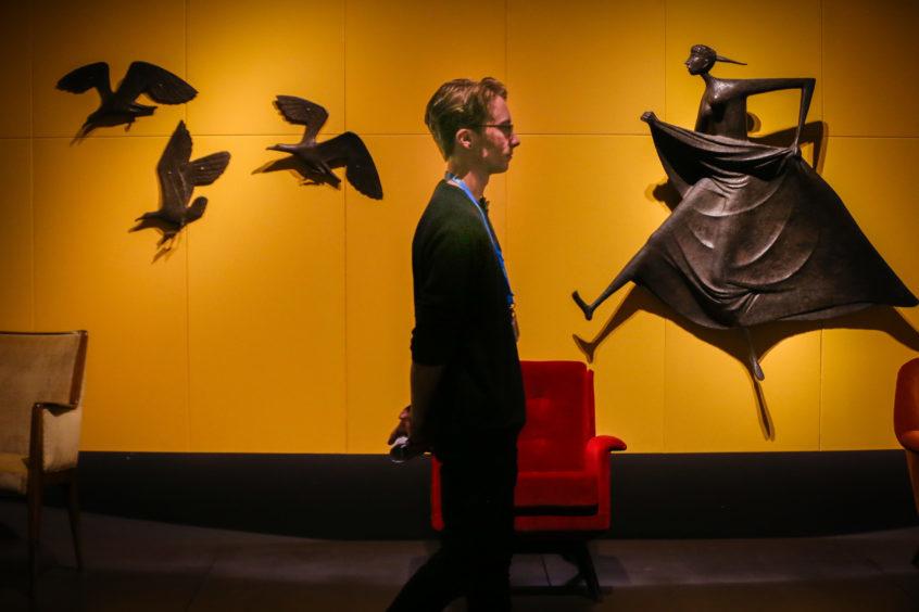 A man wanders through an exhibition space. Pic: Kris Miller.