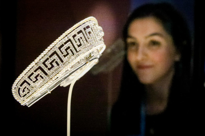 Amy Cochrane looking at a Tiara that was formerly property of Lady Marguerite Allan. Pic: Kris Miller.