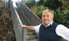 Mike Paton at his now authorised waterside haven