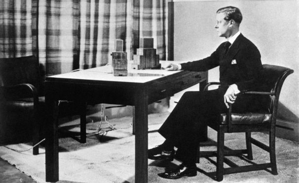 King Edward VIII makes his first broadcast to the world in 1936.