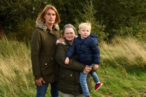 From left, Sandra Stuart, Audrey Forbes with grandson Jude Fell, 3, at the skatepark site.