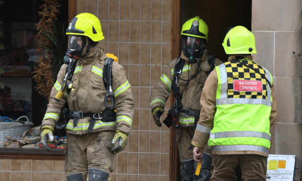Firefighters with breathing apparatus at the Princes Street property on Sunday morning.