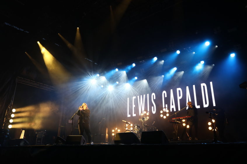 Lewis Capaldi on stage.