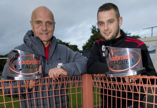 Assistant manager Ian Campbell (left) receives the Ladbrokes League 1 Manager of the Month award for August, on behalf of his brother Dick Campbell, the Arbroath manager. He's pictured alongside Ryan Wallace, also of Arbroath, who wins the Player of the Month award for August