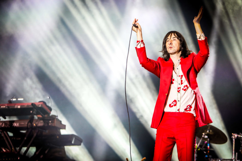 Bobby Gillespie of Primal Scream on stage.