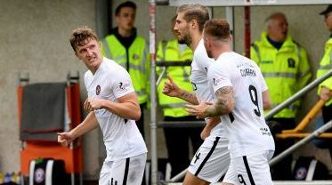 Paul Watson celebrates after opening the scoring for United.