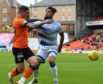 Morton's Rory McKeown gets to grips with Dundee United's Fraser Aird.