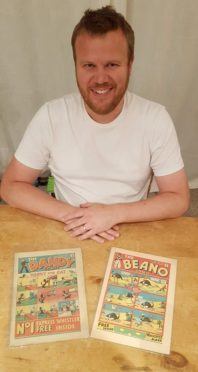 Phil with the two comics.