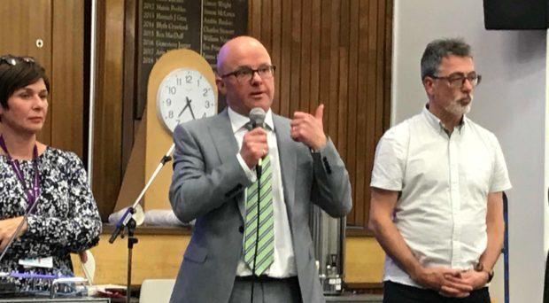Michael Kellet, centre, addresses a St Andrews meeting.