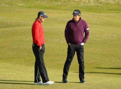 Padraig Harrington speaks with Martin Kaymer at Carnoustie yesterday.