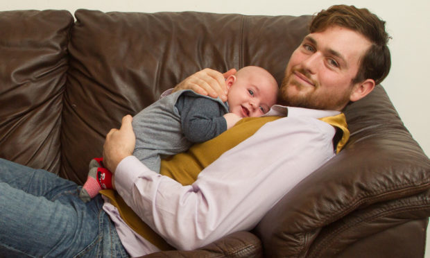 Calum MacInnes at home in Montrose with baby Lachlann.